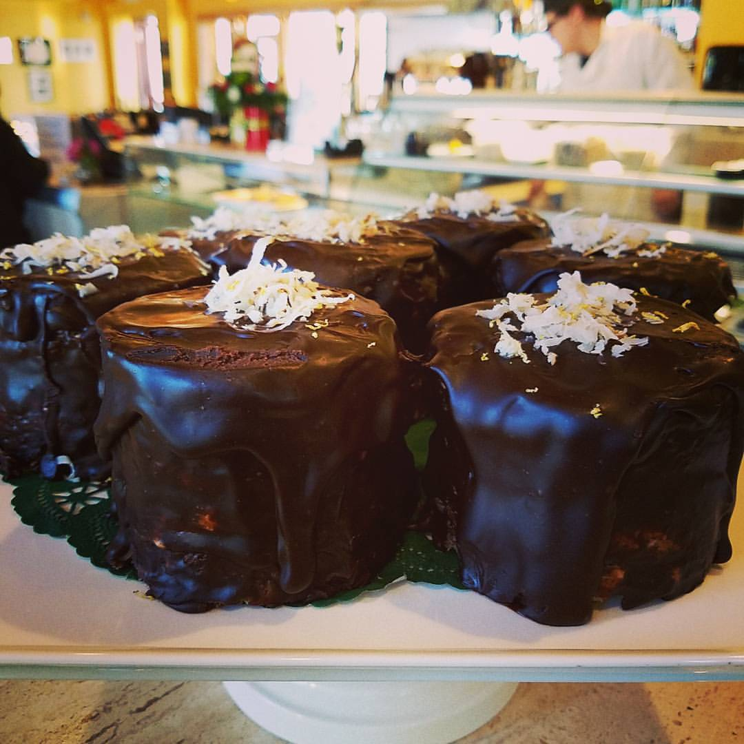 Va Bene Instagram Photo: This cold weather has me dreaming of summer in Italy. So, today I created the Capri Torte. Lemon curd, white chocolate buttercream filled, coconut cake. Covered in ganache, topped with toasted coconut and lemon zest. Stop in for a taste of summer